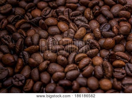 Roasted coffee beans with different brown roasts