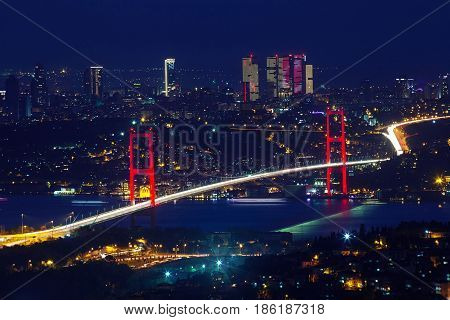 ISTANBUL TURKEY - APRIL 29 2017: 15th July Martyrs Bridge Bosphorus Bridge at night Istanbul Turkey