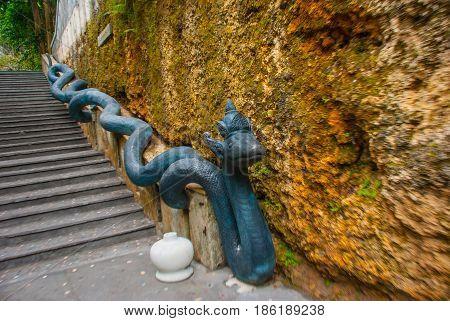 Garuda Wisnu Kencana Cultural Park, Staircase And A Sculpture Of A Huge Snake Bali. Indonesia.