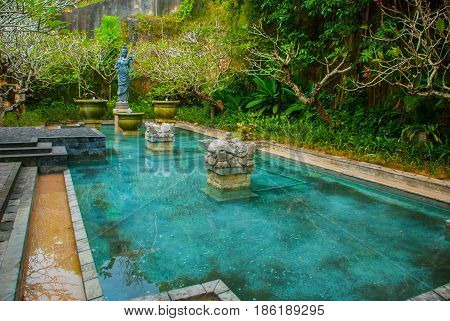 Garuda Wisnu Kencana Cultural Park, Small Pool With A Sculpture. Bali. Indonesia.