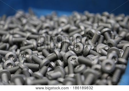 pile of gray screws in close up