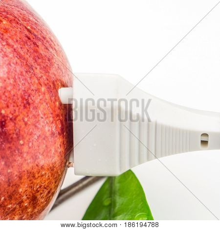 White Plug Is Connected To The Red Apple On White Background