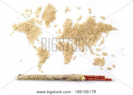 map of the world made of raw natural rice on white background with chopsticks