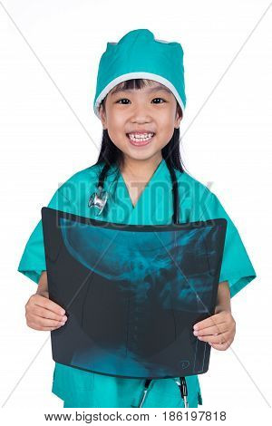 Asian Little Chinese Girl Playing Doctor With Stethoscope And X-ray