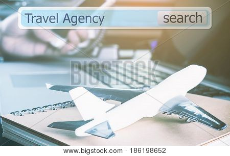 Online travel agency search box virtually in office for business travel