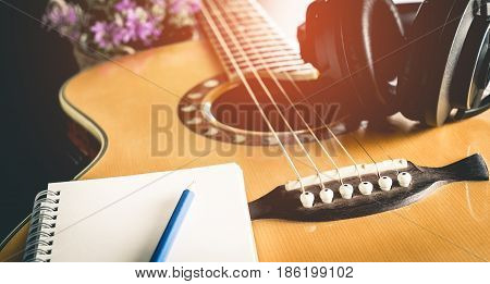 Music composer equipment with guitar and headphone for songwriting
