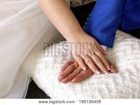 Hands of groom and fiancee. Rings are engagement on fingers a bride-couple.