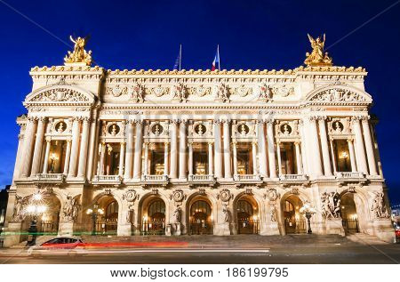 The magnificent Palais Garnier at dusk in Paris France. The Palais is a 1979-seat Opera House built for the Paris Opera.