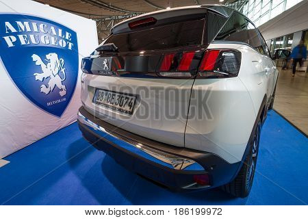STUTTGART GERMANY - MARCH 02 2017: Compact crossover Peugeot 3008 GT 2016. Rear view. Europe's greatest classic car exhibition