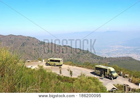 POMPEII, ITALY - October 9 2014: Buses of the Busvia del Vesuvio tours parked at the base of the trail for hiking to the top of the cinder cone of the volcano Mount Vesuvius, south of Naples, Italy.