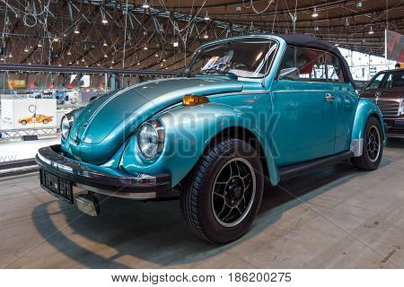 STUTTGART GERMANY - MARCH 02 2017: Subcompact car Volkswagen Beetle Cabrio 1973. Europe's greatest classic car exhibition