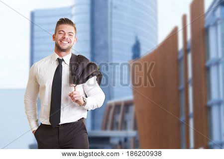 young smiling Handsome businessman portrait outside office building
