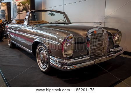 STUTTGART GERMANY - MARCH 02 2017: Full-size luxury car Mercedes-Benz 300 SE Cabriolet (W112) 1967. Europe's greatest classic car exhibition
