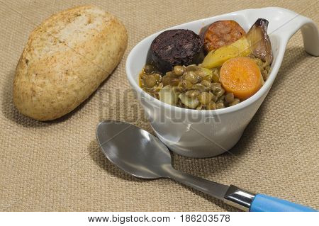 cooked lentils with sausage, carrot and potato