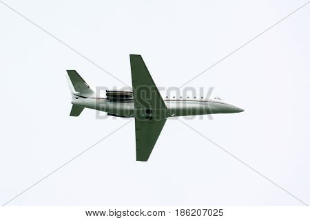 Travel background with airplane flying in the blue sky