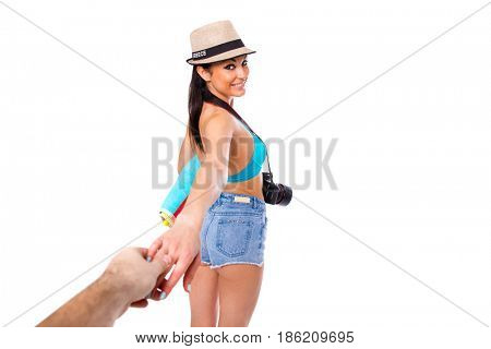 Follow me, happy young beautiful Greek woman holds a mans hand isolated on white background