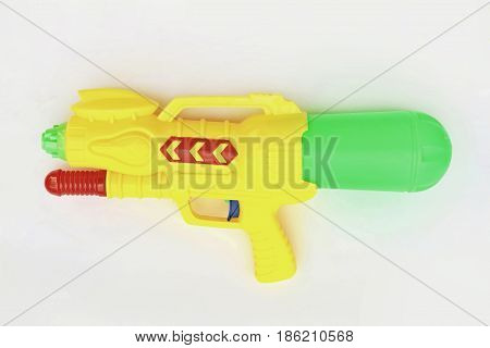 Close-up of squirt gun on white background