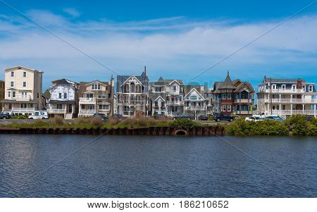 Ocean Grove NJ USA -- May 12 2017 -- Victorian and modern style houses stand side by along a waterfront in Ocean Grove NJ. Editorial Use Only