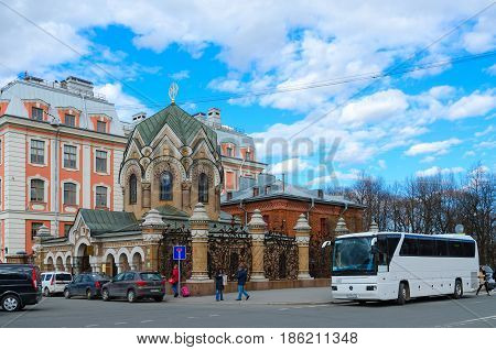 SAINT PETERSBURG RUSSIA - MAY 3 2017: Unknown people are walking near Chapel-vestry of Iberian Icon of Mother of God (Museum of Stone) on embankment of Griboedov Canal