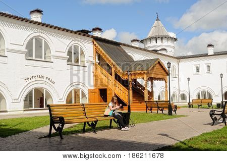 Tobolsk, Russia - July 15, 2016: Woman rests in interior of Guest Yard. Building of Gostiny dvor is built in 1703 - 1706 on project of architect, cartographer and historian of Siberia S. U. Remezov