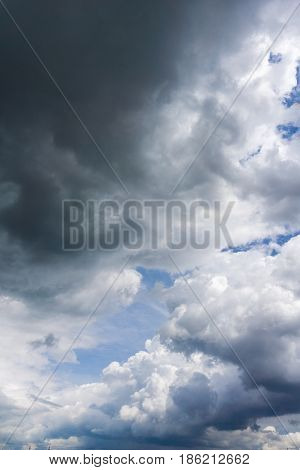 View on dramatic storm clouds in a blue sky. Clouds and Skies in the Morning.  Cloudy Weather. Cloud Formations. White and grey Clouds