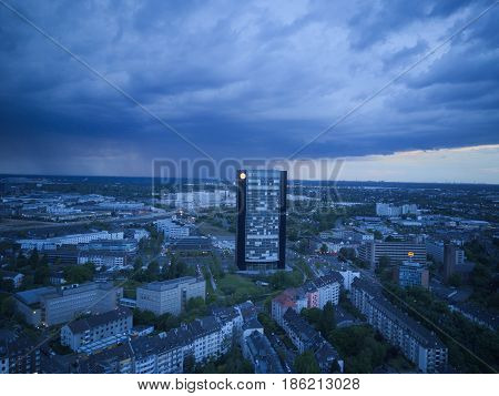 aerial photo of building contrast storm during the evening