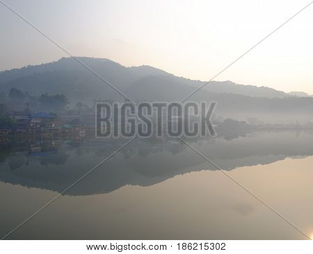 Village in the fog reflected like glass mirror water on the morning, Mae Hong Son, Thailand