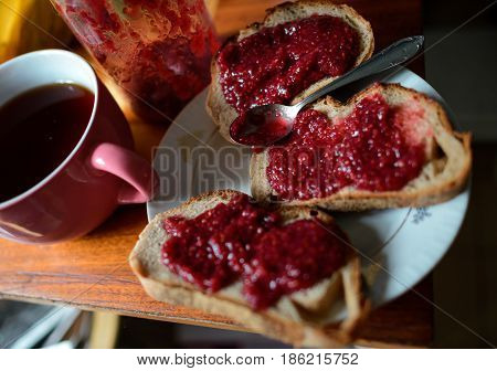 Blackcurrant Jam On Bread On Wooden