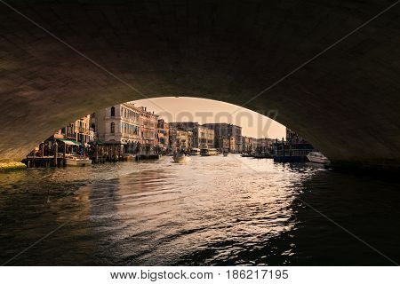 Venice Italy - April 23 2017: Grand canal at sunset seen from under the Rialto Bridge Venice Italy.