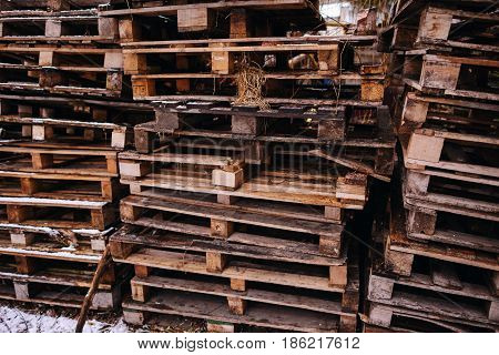 Bunch Of Old Wet Wooden Pallets On Green Grass