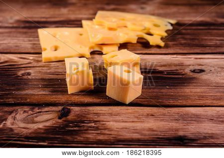 Sliced Cheese On Wooden Table