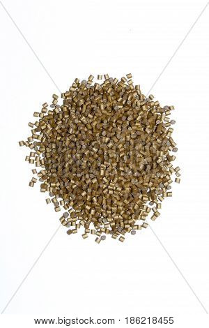 Plastic Pellets Gold Purple On White Background. Polymeric Yellow Dye. Colorant For Plastics In The