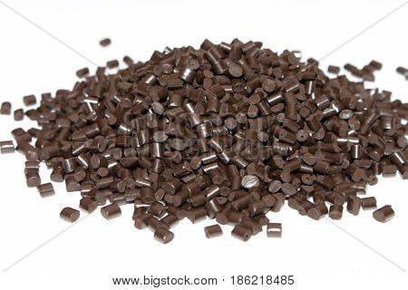 Plastic Pellets Brown On White Background. Polymeric Yellow Dye. Colorant For Plastics In The Granul