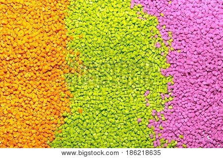 The Plastic Granules. Polymeric Dye Orange, Green And Pink . Dye For Plastics In Granules .