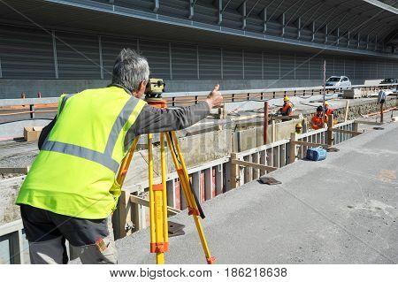 Surveyor Engineer Worker Making Measuring With Theodolite Instrument Equipment