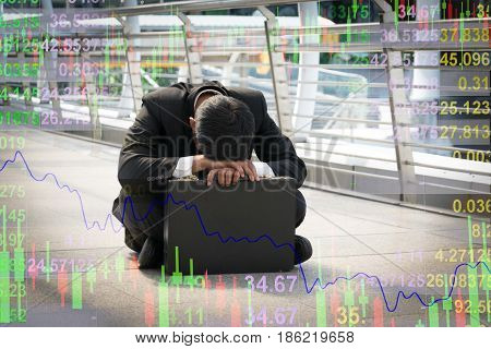 Businessman is disappointed from losing in stock exchange economic crisis concept