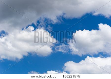 View on beautiful white clouds in a blue sky. Clouds and Skies in the Morning.  Cloudy Weather. Cloud Formations. White Clouds