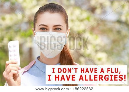 Pollen allergy. Young woman with face mask and pills outdoor