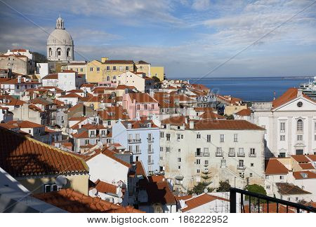 The roofs of Alfama district at sunny summer day. Lisbon Portugal