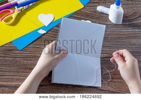 The Child Sews Details. The Child Creates A Note Pad Handmade Applique Decorated Balloon, Craft Pape