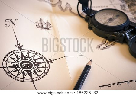 still life with compass over an old map. direction. travel. symbol. vintage