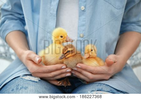 Woman with cute little birds, closeup