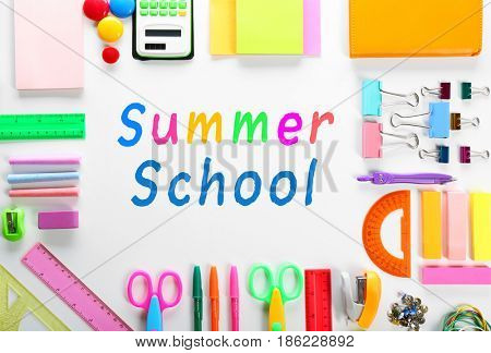 Text SUMMER SCHOOL and stationery on white background