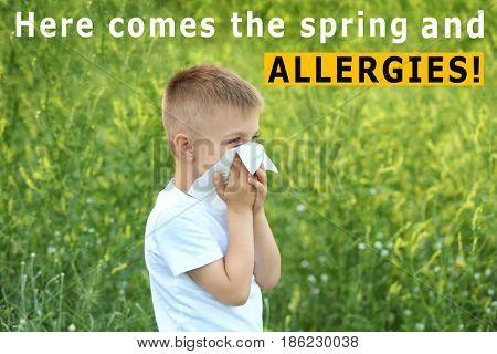 Pollen allergy. Little boy with tissue outdoor