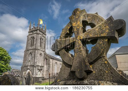 Celtic cross on a tomb in a cemetery in Limerick, Ireland
