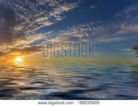 Beautiful sea landscape with dramatic sky with clouds and sun reflected in a water surface with small waves