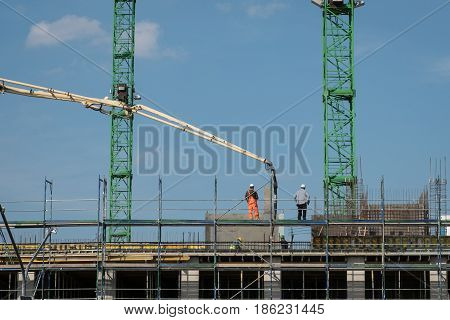 Construction Workers Pour Concrete