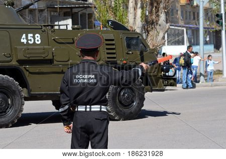 Kazakhstan police during  parade.V-day celebration.Russian military transport background.Sary Shagan.Former Soviet  anti-ballistic missile testing range.Kazakhstan.May 9, 2017.Priozersk.Kazakhstan