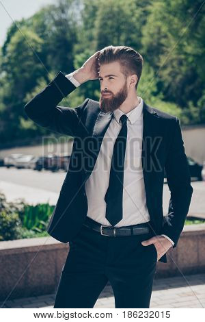 Successful Young Hot Bearded Guy In Classy Suit. So Fashionable And Harsh. Outdoors On Sunny Day