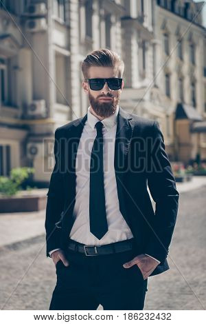 Young Successful Stunning Bearded Guy Otside, In A Suit And Sunglasses. So Harsh And Severe